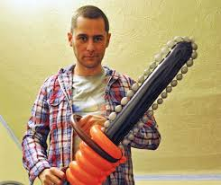 OK maybe you wouldn't hire this guy for your kid's party, but that balloon chainsaw is cool.